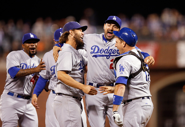 SAN FRANCISCO, CA - SEPTEMBER 29: (L-R) Clayton Kershaw #22, Adrian Gonzalez #23 and A.J. Ellis #17 of the Los Angeles Dodgersn celebrate after they beat the San Francisco Giants to clinch the National League West title at AT&T Park on September 29, 2015 in San Francisco, California. (Photo by Ezra Shaw/Getty Images)