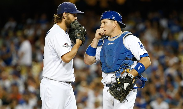 LOS ANGELES, CA - OCTOBER 09: Clayton Kershaw #22 talks with A.J. Ellis #17 of the Los Angeles Dodgers on the mound in the seventh inning in game one of the National League Division Series at Dodger Stadium on October 9, 2015 in Los Angeles, California. (Photo by Sean M. Haffey/Getty Images)