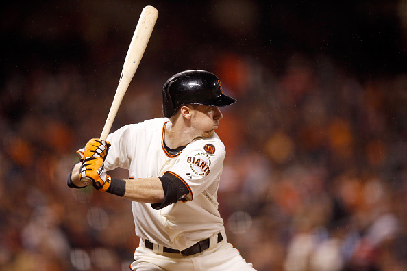 SAN FRANCISCO, CA - SEPTEMBER 16:  Matt Duffy #5 of the San Francisco Giants bats against the Cincinnati Reds at AT&T Park on September 16, 2015 in San Francisco, California.  (Photo by Ezra Shaw/Getty Images)
