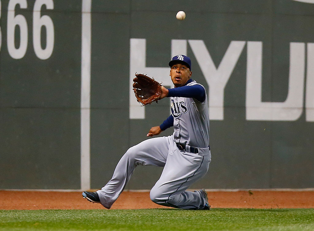 BOSTON, MA - MAY 31: Desmond Jennings #8 of the Tampa Bay Rays catches a fly ball in center field in the 7th inning against the Boston Red Sox during the game at Fenway Park on May 31, 2014 in Boston, Massachusetts.  (Photo by Jared Wickerham/Getty Images)