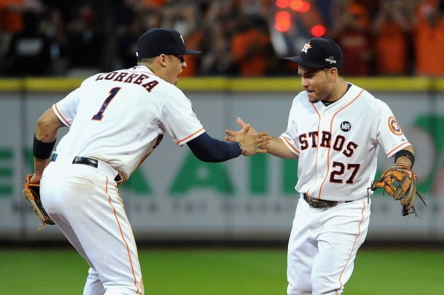 HOUSTON, TX - OCTOBER 11: Carlos Correa #1 of the Houston Astros celebrates with Jose Altuve #27 of the Houston Astros after the Houston Astros defeat the Kansas City Royals in game three of the American League Division Series at Minute Maid Park on October 11, 2015 in Houston, Texas. The Houston Astros defeated the Kansas City Royals with a score of 4 to 2. (Photo by Eric Christian Smith/Getty Images)