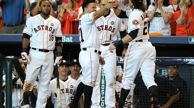 HOUSTON, TX - OCTOBER 12: Colby Rasmus #28 of the Houston Astros celebrates with teammates after hitting a solo home run in the seventh inning against the Kansas City Royals during game four of the American League Divison Series at Minute Maid Park on October 12, 2015 in Houston, Texas. (Photo by Eric Christian Smith/Getty Images)