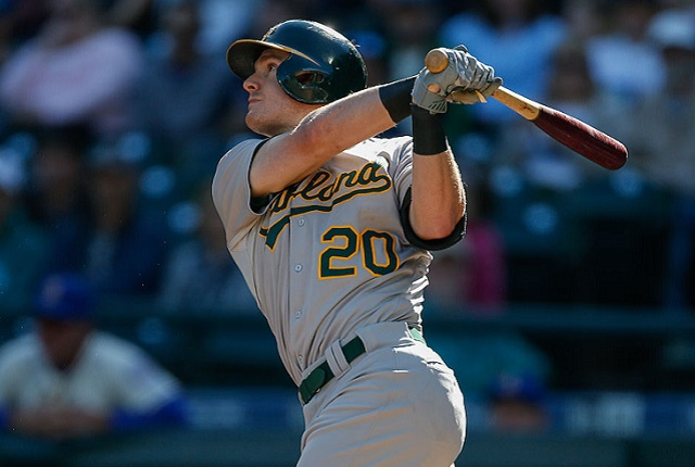 SEATTLE, WA - OCTOBER 04:  Mark Canha #20 of the Oakland Athletics hits a solo home run against the Seattle Mariners in the third inning at Safeco Field on October 4, 2015 in Seattle, Washington.  (Photo by Otto Greule Jr/Getty Images) *** Local Caption *** Mark Canha