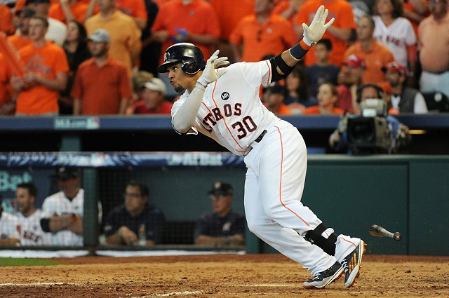 HOUSTON, TX - OCTOBER 11: Carlos Gomez #30 of the Houston Astros hits an RBI single in the sixth inning against the Kansas City Royals in game three of the American League Division Series at Minute Maid Park on October 11, 2015 in Houston, Texas. (Photo by Eric Christian Smith/Getty Images)