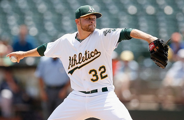 OAKLAND, CA - JULY 01: Jesse Hahn #32 of the Oakland Athletics pitches against the Colorado Rockies in the first inning at O.co Coliseum on July 1, 2015 in Oakland, California. (Photo by Ezra Shaw/Getty Images)