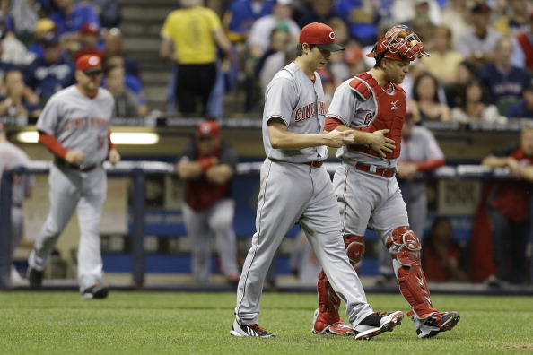 MILWAUKEE, WI - JUNE 13: Homer Bailey #34 of the Cincinnati Reds and Devin Mesoraco #39 walk to the pitchers mound during the bottom of the fourth inning against the Milwaukee Brewers at Miller Park on June 13, 2014 in Milwaukee, Wisconsin. (Photo by Mike McGinnis/Getty Images)