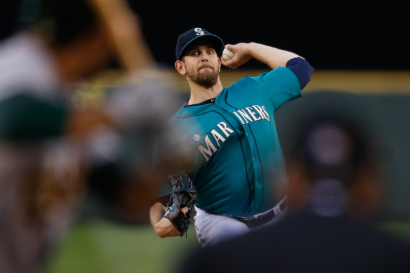 SEATTLE, WA - SEPTEMBER 12:  Starting pitcher James Paxton #65 of the Seattle Mariners pitches against the Oakland Athletics in the first inning at Safeco Field on September 12, 2014 in Seattle, Washington.  (Photo by Otto Greule Jr/Getty Images)