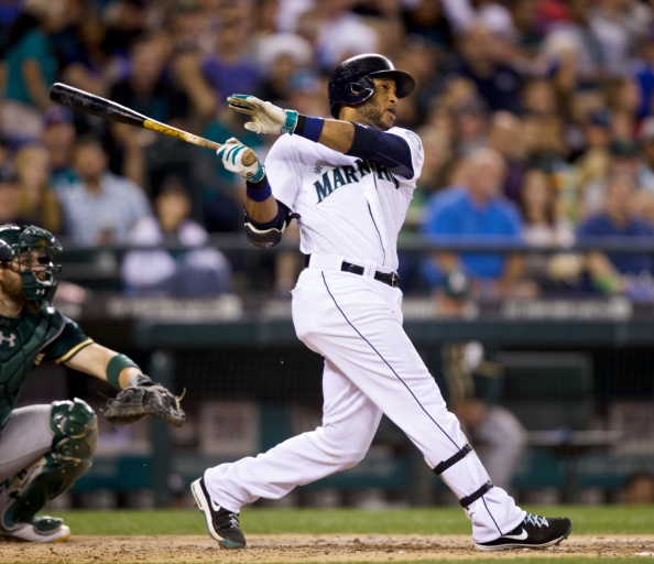 SEATTLE, WA - SEPTEMBER 13: Seattle Mariners' Robinson Cano #22 hits a solo home run in the seventh inning of a baseball game against the Oakland Athletics at Safeco Field on September 13, 2014 in Seattle, Washington. (Photo by Stephen Brashear/Getty Images)