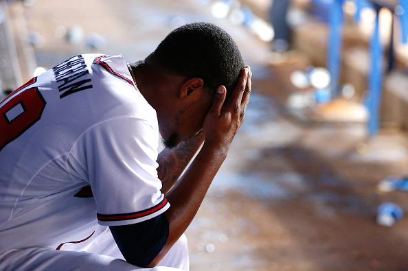 ATLANTA, GA - APRIL 28:  Julio Teheran #49 of the Atlanta Braves reacts in the dugout after being pulled following a solo homer by Denard Span #2 of the Washington Nationals in the sixth inning at Turner Field on April 28, 2015 in Atlanta, Georgia.  (Photo by Kevin C. Cox/Getty Images)