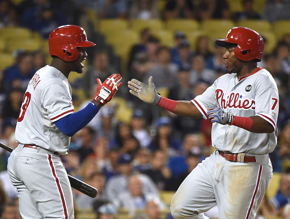 LOS ANGELES, CA - JULY 06: Maikel Franco #7 of the Philadelphia Phillies celebrates his run with Odubel Herrera #37 to tie the game 7-7 with the Los Angeles Dodgers during the seventh inning at Dodger Stadium on July 6, 2015 in Los Angeles, California. (Photo by Harry How/Getty Images)