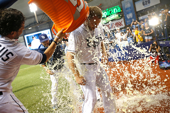 ST. PETERSBURG, FL - JULY 10:  Pitcher Brad Boxberger #26 of the Tampa Bay Rays gets doused with sports drink by teammates David DeJesus #7, left, and Steven Souza Jr. #20 following the Rays' 3-1 win over the Houston Astros  on July 10, 2015 at Tropicana Field in St. Petersburg, Florida.  (Photo by Brian Blanco/Getty Images)