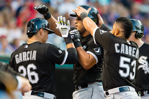 CLEVELAND, OH -  JULY 24: Avisail Garcia #26 and Melky Cabrera #53 of the Chicago White Sox celebrate with Jose Abreu #79  after Abreu hit a solo home run during the sixth inning against the Cleveland Indians at Progressive Field on July 24, 2015 in Cleveland, Ohio. (Photo by Jason Miller/Getty Images)