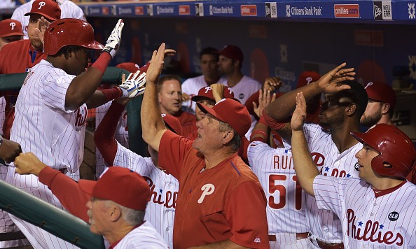 PHILADELPHIA, PA - AUGUST 04: Maikel Franco #7 of the Philadelphia Phillies is congratulated by teammates and coaches after hitting a grand slam in the seventh inning against the Los Angeles Dodgers at Citizens Bank Park on August 4, 2015 in Philadelphia, Pennsylvania. (Photo by Drew Hallowell/Getty Images)