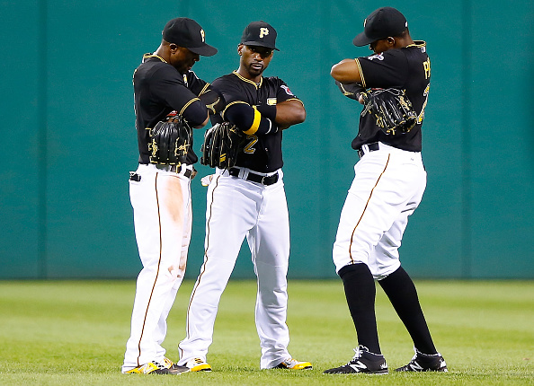 PITTSBURGH, PA - AUGUST 05: Starling Marte #6, Andrew McCutchen #22, and Gregory Polanco #25 of the Pittsburgh Pirates celebrate their 7-5 win against the Chicago Cubs during the game at PNC Park on August 5, 2015 in Pittsburgh, Pennsylvania.  (Photo by Jared Wickerham/Getty Images)