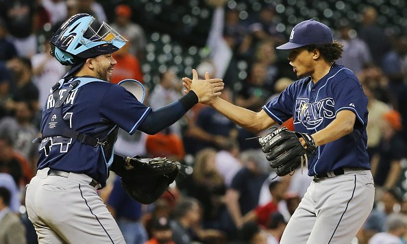 HOUSTON, TX - AUGUST 20:  Chris Archer #22 of the Tampa Bay Rays celebrates with his catcher Rene Rivera #44 after his one-hit complete game shutout as the Rays defeated the Houston Astros 1-0 at Minute Maid Park on August 20, 2015 in Houston, Texas.  (Photo by Scott Halleran/Getty Images)