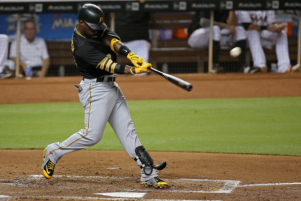 MIAMI, FL - AUGUST 26:  Andrew McCutchen #22 of the Pittsburgh Pirates hits a three run home run during a game against the Miami Marlins at Marlins Park on August 26, 2015 in Miami, Florida.  (Photo by Mike Ehrmann/Getty Images)