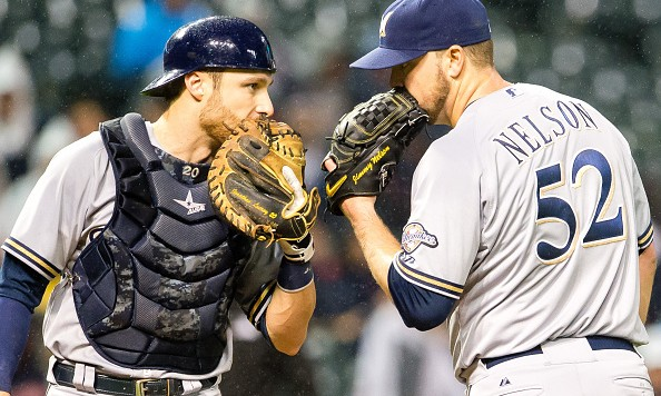 CLEVELAND, OH - AUGUST 26: Catcher Jonathan Lucroy #20 of the Milwaukee Brewers talks with starting pitcher Jimmy Nelson #52 of the Milwaukee Brewers during the third inning against the Cleveland Indians at Progressive Field on August 26, 2015 in Cleveland, Ohio. (Photo by Jason Miller/Getty Images)