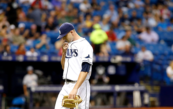 ST. PETERSBURG, FL - AUGUST 27:  Pitcher Drew Smyly #33 of the Tampa Bay Rays makes his way to the dugout after being taken off of the mound by manager Kevin Cash #16 during the fifth inning of a game against the Minnesota Twins on August 27, 2015 at Tropicana Field in St. Petersburg, Florida.  (Photo by Brian Blanco/Getty Images) *** Local Caption *** name here