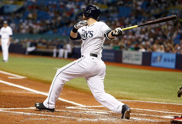ST. PETERSBURG, FL - SEPTEMBER 11:  Steven Souza Jr. #20 of the Tampa Bay Rays hits an RBI single off of pitcher Wade Miley #20 of the Boston Red Sox to score Evan Longoria #3 during the first inning of a game on September 11, 2015 at Tropicana Field in St. Petersburg, Florida.  (Photo by Brian Blanco/Getty Images)