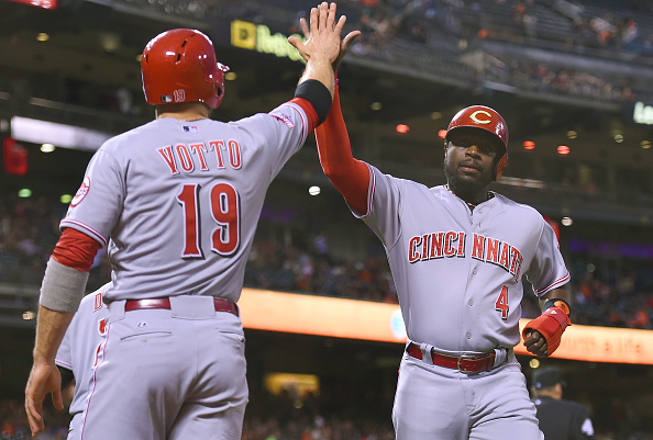 SAN FRANCISCO, CA - SEPTEMBER 15:  Brandon Phillips #4 and Joey Votto #19 of the Cincinnati Reds celebrate after both scored on a triple by Ivan De Jesus (not pictured) against the San Francisco Giants in the top of the first inning at AT&T Park on September 15, 2015 in San Francisco, California.  (Photo by Thearon W. Henderson/Getty Images)