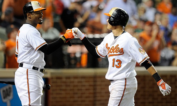 BALTIMORE, MD - SEPTEMBER 15:  Manny Machado #13 of the Baltimore Orioles celebrates with Adam Jones after hitting a home run in the fifth inning against the Boston Red Sox at Oriole Park at Camden Yards on September 15, 2015 in Baltimore, Maryland.  (Photo by Greg Fiume/Getty Images)