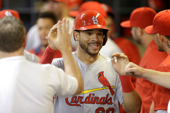 MILWAUKEE, WI - SEPTEMBER 17: Tommy Pham #60 of the St. Louis Cardinals celebrates in the dugout after reaching on a single hit by Jason Heyward in the third inning against the Milwaukee Brewers at Miller Park on September 17, 2015 in Milwaukee, Wisconsin. (Photo by Mike McGinnis/Getty Images)  *** Local Caption *** Tommy Pham
