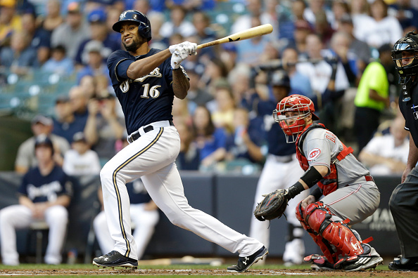 MILWAUKEE, WI - SEPTEMBER 19: Domingo Santana #16 of the Milwaukee Brewers hits a 2 RBI double in the first inning against the Cincinnati Reds at Miller Park on September 19, 2015 in Milwaukee, Wisconsin. (Photo by Mike McGinnis/Getty Images)
