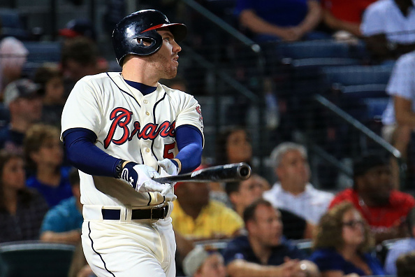 ATLANTA, GA - SEPTEMBER 19:  Freddie Freeman #5 of the Atlanta Braves hits a two-RBI double during the eighth inning against the Philadelphia Phillies at Turner Field on September 19, 2015 in Atlanta, Georgia.  (Photo by Daniel Shirey/Getty Images)