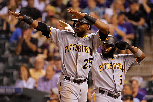 DENVER, CO - SEPTEMBER 23: Gregory Polanco #25 and Josh Harrison #5 of the Pittsburgh Pirates celebrate after scoring on a double by Starling Marte #6 of the Pittsburgh Pirates off of starting pitcher Christian Bergman #36 of the Colorado Rockies to take a 7-1 lead in the fourth inning at Coors Field on September 23, 2015 in Denver, Colorado. (Photo by Doug Pensinger/Getty Images)