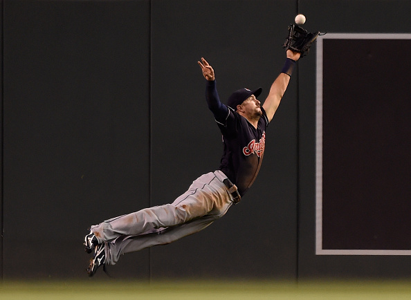 MINNEAPOLIS, MN - SEPTEMBER 24: Lonnie Chisenhall #8 of the Cleveland Indians misses a catch of on a ball off the bat of Aaron Hicks of the Minnesota Twins that went for a double in right field during the first inning of the game on September 24, 2015 at Target Field in Minneapolis, Minnesota. (Photo by Hannah Foslien/Getty Images)