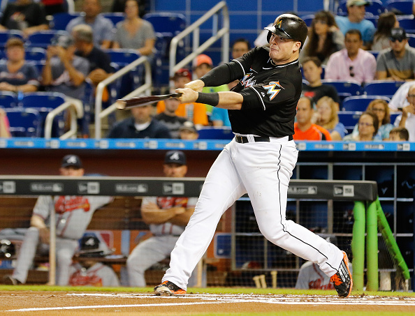 MIAMI, FL - SEPTEMBER 27:  Justin Bour #48 of the Miami Marlins hits a two-run home run against the Atlanta Braves in the first inning at Marlins Park on September 27, 2015 in Miami, Florida.  (Photo by Joe Skipper/Getty Images)