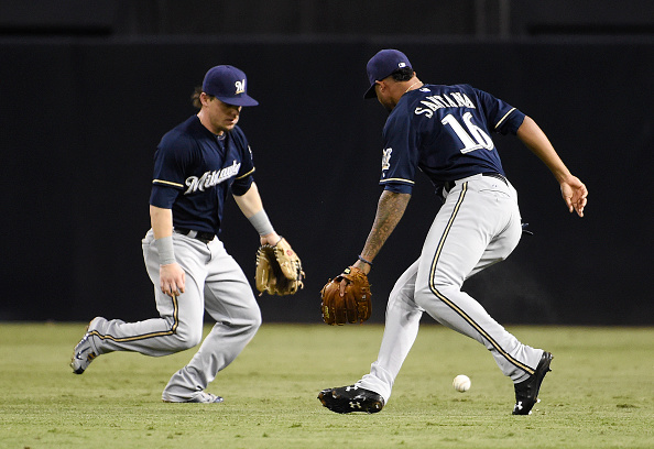SAN DIEGO, CA - SEPTEMBER 29:  Domingo Santana #16 of the Milwaukee Brewers, right, and Scooter Gennett #2 can't make the catch on a ball hit by Austin Hedges #18 of the San Diego Padres during the second inning of a baseball game at Petco Park September 29, 2015 in San Diego, California.  Santana was charged with an error on the play. (Photo by Denis Poroy/Getty Images)