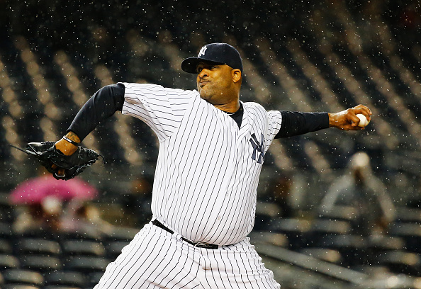 NEW YORK, NY - OCTOBER 01: CC Sabathia #52 of the New York Yankees pitches against the Boston Red Sox during their game at Yankee Stadium on October 1, 2015 in New York City. (Photo by Al Bello/Getty Images)