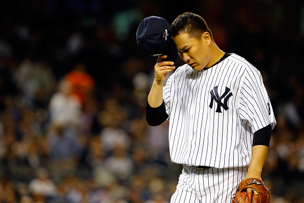 NEW YORK, NY - OCTOBER 06:  Masahiro Tanaka #19 of the New York Yankees reacts against the Houston Astros during the American League Wild Card Game at Yankee Stadium on October 6, 2015 in New York City.  (Photo by Al Bello/Getty Images)