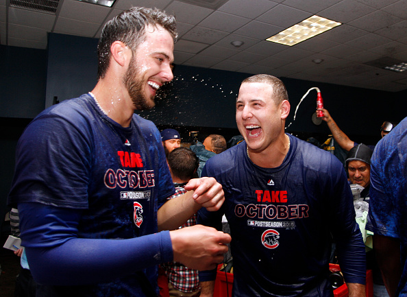 PITTSBURGH, PA - OCTOBER 07:  Anthony Rizzo #44 of the Chicago Cubs and Kris Bryant #17 celebrate in the locker room after defeating the Pittsburgh Pirates in the National League Wild Card game at PNC Park on October 7, 2015 in Pittsburgh, Pennsylvania.  (Photo by Justin K. Aller/Getty Images)