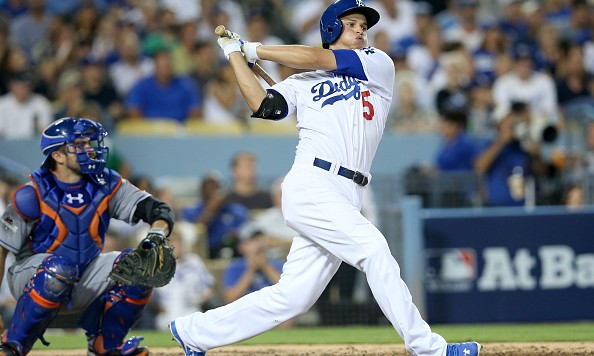 LOS ANGELES, CA - OCTOBER 09:  Corey Seager #5 of the Los Angeles Dodgers hits a double in the third inning against the New York Mets in game one of the National League Division Series at Dodger Stadium on October 9, 2015 in Los Angeles, California.  (Photo by Stephen Dunn/Getty Images)