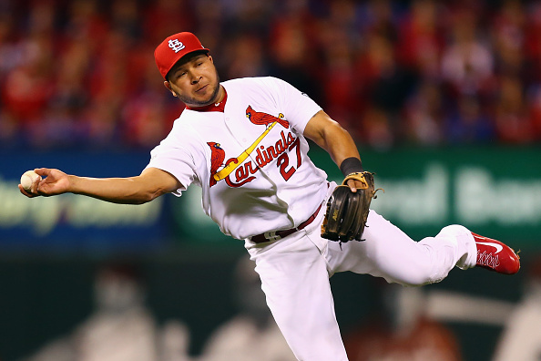 ST LOUIS, MO - OCTOBER 09:  Jhonny Peralta #27 of the St. Louis Cardinals attempts to throw a runner out in the seventh inning against the Chicago Cubs during game one of the National League Division Series at Busch Stadium on October 9, 2015 in St Louis, Missouri.  (Photo by Dilip Vishwanat/Getty Images)