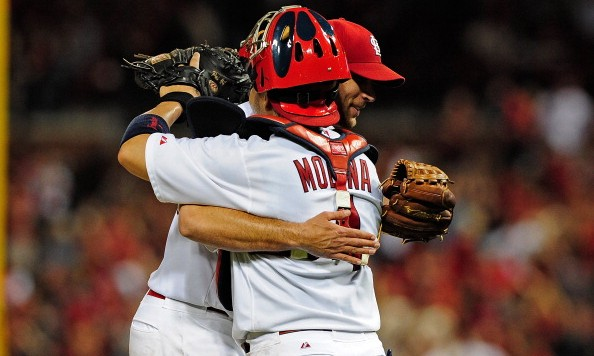 ST. LOUIS, MO - MAY 20:  Pitcher Adam Wainwright #50 of the St. Louis Cardinals celebrates with catcher Yadier Molina #4 after throwing a one-hit complete game shutout against the Arizona Diamondbacks at Busch Stadium on May 20, 2014 in St. Louis, Missouri. The Cardinals won 5-0.  (Photo by Jeff Curry/Getty Images)
