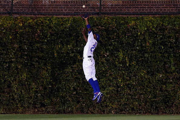 CHICAGO, IL - OCTOBER 20:  Dexter Fowler #24 of the Chicago Cubs catches a pop up fly hit by Yoenis Cespedes #52 of the New York Mets in the third inning during game three of the 2015 MLB National League Championship Series at Wrigley Field on October 20, 2015 in Chicago, Illinois.  (Photo by Elsa/Getty Images)