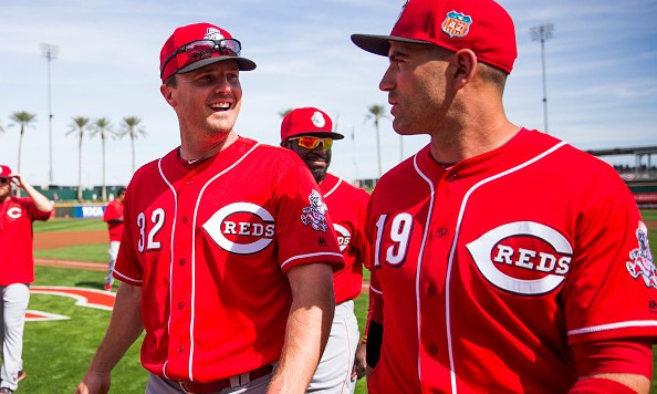 GOODYEAR, AZ - MARCH 1: Jay Bruce #32 and Joey Votto #19 of the Cincinnati Reds look on before a spring training game against the Cleveland Indians at Goodyear Ballpark on March 1, 2016 in Goodyear, Arizona. (Photo by Rob Tringali/Getty Images)