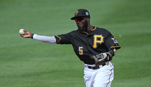 BRADENTON FL- MARCH 3: Third baseman Josh Harrison #5 of the Pittsburgh Pirates makes the throw to first base during the first inning of the Spring Training Game against the Toronto Blue Jays on March 3, 2016 at McKechnie Field in Bradenton, Florida. The Blue Jays defeated the Pirates 10-8. (Photo by Leon Halip/Getty Images)