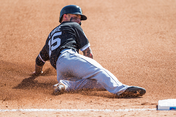 GLENDALE, AZ - MARCH 03: Brett Lawrie #15 of the Chicago White Sox slides into third base during a spring training game against the Los Angeles Dodgers at Camelback Ranch on March 3, 2016 in Glendale, Arizona. (Photo by Rob Tringali/Getty Images)