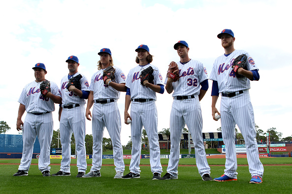 JUPITER, FL - MARCH 01:  Pitchers (L-R) Bartolo Colon, Matt Harvey, Noah Syndergaard, Jacob deGrom, Steven Matz and Zack Wheeler pose for photos during media day at Traditions Field on March 1, 2016 in Port St. Lucie, Florida.  (Photo by Marc Serota/Getty Images)