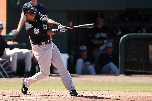 LAKELAND, FL - MARCH 04:  Starlin Castro #14 of the New York Yankees swings at a pitch during the fifth inning of a spring training game against the Detroit Tigers at Joker Marchant Stadium on March 4, 2016 in Lakeland, Florida.  (Photo by Stacy Revere/Getty Images)