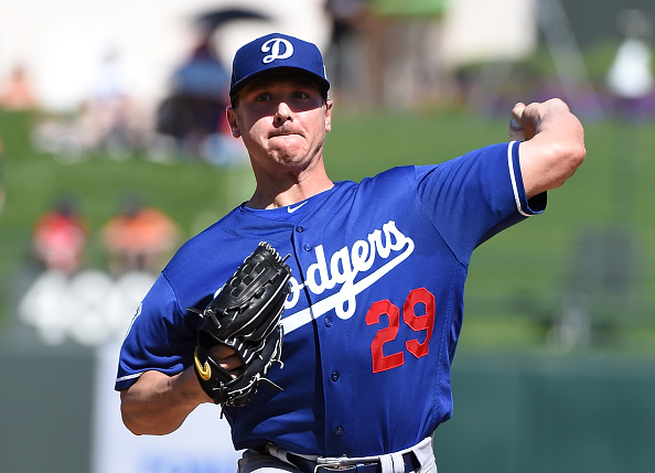 SURPRISE, AZ - MARCH 04:  Scott Kazmir #29 of the Los Angeles Dodgers delivers a warm up pitch prior to a game against the Texas Rangers at Surprise Stadium on March 4, 2016 in Surprise, Arizona.  (Photo by Norm Hall/Getty Images)