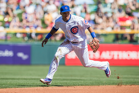 MESA, AZ - MARCH 4: Addison Russell #27 of the Chicago Cubs defends his position during a spring training game against the Los Angeles Angels at Sloan Park on March 4, 2016 in Mesa, Arizona. (Photo by Rob Tringali/Getty Images) *** Local Caption *** Addison Russell