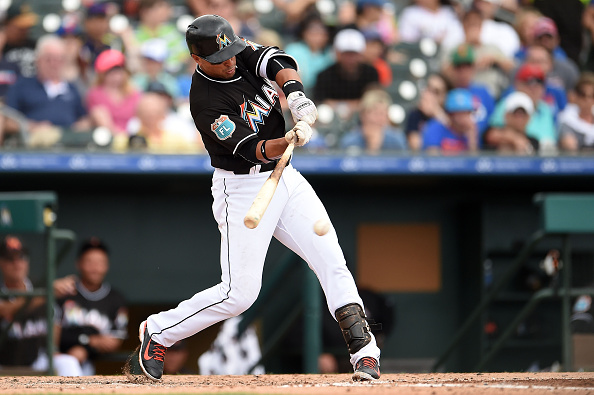 JUPITER, FL - MARCH 13:  Martin Prado #14 of the Miami Marlins swings at a pitch during the fifth inning of a spring training game against the New York Mets at Roger Dean Stadium on March 13, 2016 in Jupiter, Florida.  (Photo by Stacy Revere/Getty Images)