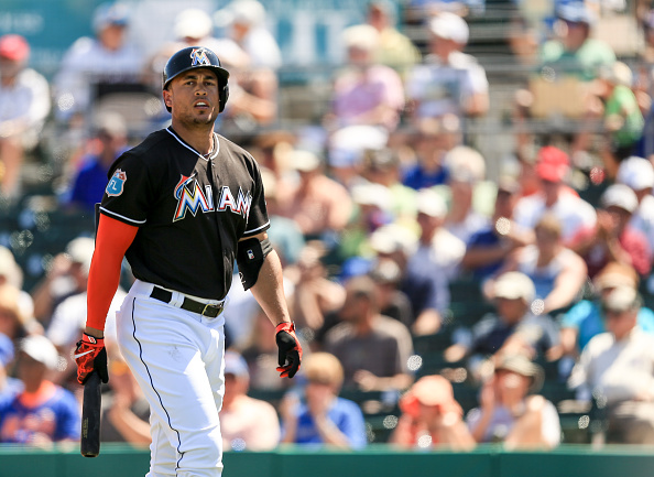 JUPITER, FL - MARCH 15: Giancarlo Stanton #27 of the Miami Marlins reacts after striking out during the spring training game against the New York Mets on March 15, 2016 in Jupiter, Florida. (Photo by Rob Foldy/Getty Images)