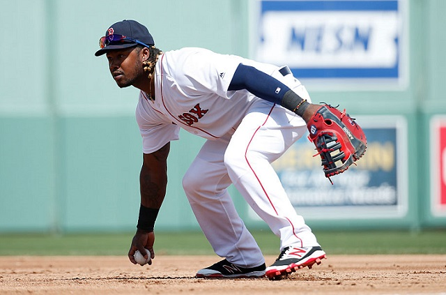 FORT MYERS, FL - MARCH 2: Hanley Ramirez #13 of the Boston Red Sox bobbles the ball while fielding at first base against the Minnesota Twins in the second inning of a spring training game at JetBlue Park at Fenway South on March 2, 2016 in Fort Myers, Florida. The Twins defeated the Red Sox 7-4. (Photo by Joe Robbins/Getty Images)