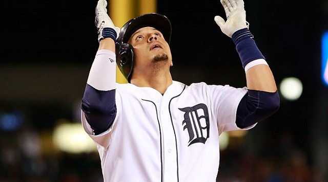 DETROIT, MI - SEPTEMBER 19: Victor Martinez #41 of the Detroit Tigers celebrates after hitting a two run home run scoring Miguel Cabrera #24 (not in photo) during the seventh inning of the game against the Kansas City Royals on September 19, 2015 at Comerica Park in Detroit, Michigan. (Photo by Leon Halip/Getty Images)